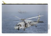 A Mh-60s Knighthawk Conducts A Vertical Carry-all Pouch by Gert Kromhout