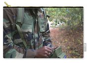 A Military Technician Uses A Pda Carry-all Pouch by Michael Wood