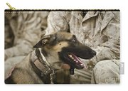 A Military Working Dog Sits At The Feet Carry-all Pouch by Stocktrek Images