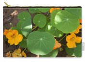 A Mix Of Orange Flowers And Round Green Leaves With Sun And Shadow Carry-all Pouch