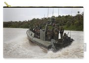 A Navy Riverine Patrol Boat Conducts Carry-all Pouch