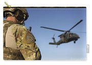 A Pararescueman Awaits The Landing Carry-all Pouch