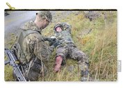 A Patrol Medic Applies First Aid Carry-all Pouch