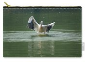 A Pelican Drying Its Wings After Landing In The Lake Inside Delhi Zoo Carry-all Pouch