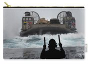 A Sailor Guides A Landing Craft Air Carry-all Pouch