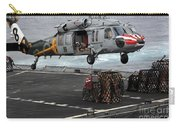 A Sailor Hooks Cargo To An Mh-60s Sea Carry-all Pouch