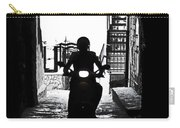 a scooter rider in the back light in a narrow street in Italy Carry-all Pouch by Joana Kruse