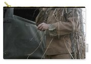 A Scout Observer Applies Camouflage Carry-all Pouch by Stocktrek Images
