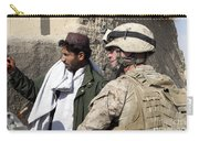 A Soldier Talks To A Local Villager Carry-all Pouch