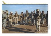 A Soldier Teaches How To Properly Carry-all Pouch by Stocktrek Images
