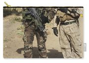 A Spanish Marine Points Out An Carry-all Pouch
