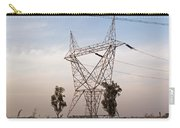 A Transmission Tower Carrying Electric Lines In The Countryside Carry-all Pouch