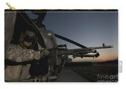 A Uh-60l Blackhawk Door Gunner Mans Carry-all Pouch