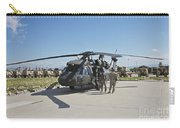 A Uh-60l Blackhawk Parked On Its Pad Carry-all Pouch