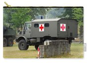 A Unimog In An Ambulance Version In Use Carry-all Pouch by Luc De Jaeger