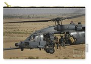 A U.s. Air Force Hh-60 Pavehawk Flies Carry-all Pouch by Stocktrek Images