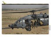 A U.s. Air Force Hh-60 Pavehawk Flies Carry-all Pouch