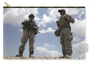 A U.s. Army Soldier Communicates Carry-all Pouch by Stocktrek Images