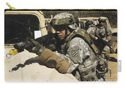 A U.s. Army Soldier Pulls Security Carry-all Pouch