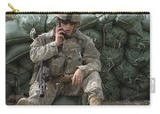 A U.s. Army Soldier Talks On A Radio Carry-all Pouch