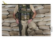 A U.s. Police Officer Contractor Leans Carry-all Pouch