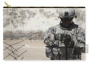 A U.s. Soldier Tests A Tactical Carry-all Pouch
