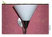 A Wall Mounted Lamp Set Against A Pink Printed Wall Color Carry-all Pouch