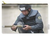 Afghan Police Student Prepares Carry-all Pouch