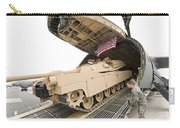 Airmen Load A Tank Into A C-5m Super Carry-all Pouch
