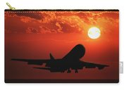 Airplane Landing At Sunset Carry-all Pouch