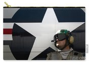 An Airman Stands In Front Of A C-2a Carry-all Pouch