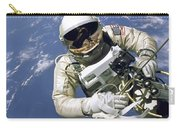 An Astronaut Floats And Maneuvers Carry-all Pouch