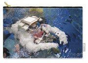 An Astronaut Is Submerged In The Water Carry-all Pouch by Stocktrek Images