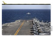 An Av-8b Takes Off From The Flight Deck Carry-all Pouch