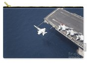 An Fa-18 Hornet Flys Over Aircraft Carry-all Pouch by Stocktrek Images