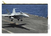An Fa-18c Hornet Lands Aboard Carry-all Pouch