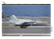 An Fa-18c Hornet Lands Aboard Uss Carry-all Pouch
