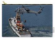 An Hh-60g Pave Hawk Performs A Hoist Carry-all Pouch