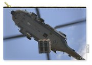 An Mh-60s Seahawk Helicopter Airlifts Carry-all Pouch