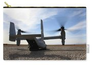 An Mv-22 Osprey Sits Outside A Forward Carry-all Pouch