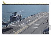 An Sh-60 Sea Hawk Helicopter Lands Carry-all Pouch