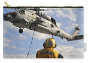 An Sh-60b Sea Hawk Helicopter Releases Carry-all Pouch