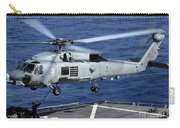 An Sh-60b Seahawk Helicopter Performs Carry-all Pouch