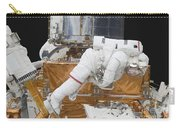 Astronaut Working On The Hubble Space Carry-all Pouch