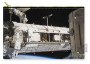 Astronauts Continue Maintenance Carry-all Pouch