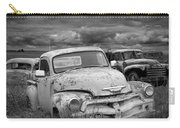 Black And White Photograph Of A Junk Yard With Vintage Auto Bodies Carry-all Pouch
