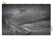 Boat Stranded On A Beach Covered By Menacing Storm Clouds Carry-all Pouch