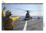 Boatswain's Mate Directs A Ch-46 Sea Carry-all Pouch