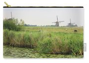 Dutch Landscape With Windmills And Cows Carry-all Pouch by Carol Groenen