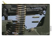 Expended Brass Falls From A Machine Gun Carry-all Pouch